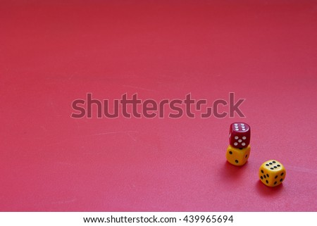 Dices on a matte red background. Concept of luck, gambling or chance. Three color dices. - stock photo