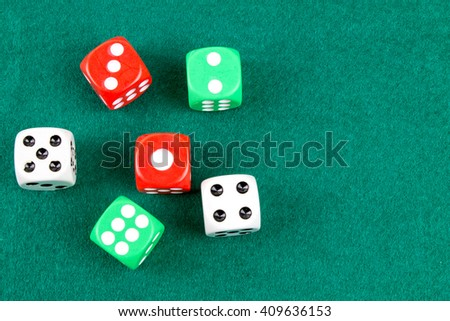 Dices on Green Table.