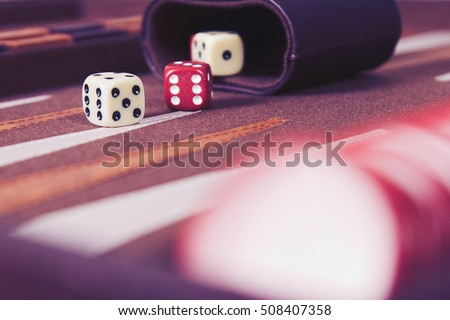 Dices set to play backgammon.Back gammon table game.Classic table gamble games.Play this ancient Turkish and Persian table game with strategy and luck.Rolling dice in old board game.Close up,macro