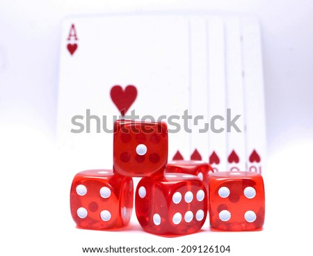 dices with royal flush poker cards in background - stock photo