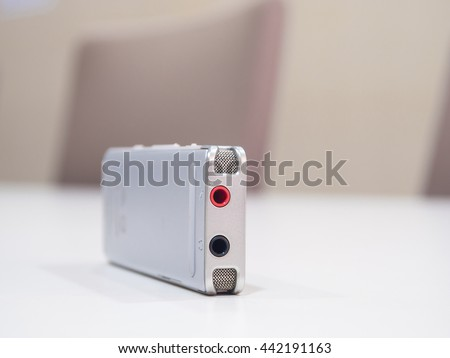 Dictaphone on white table while business meeting close up