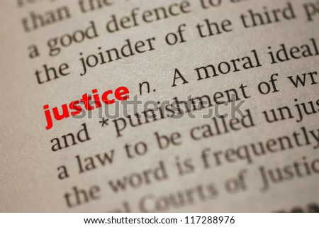 Dictionary definition of Justice. Close-up view, with  paper textures