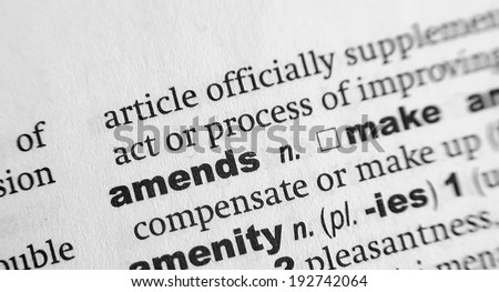 Dictionary definition of the word Amends - stock photo