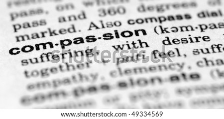 Dictionary entry for compassion - stock photo