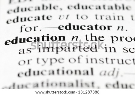 Dictionary macro photo with selective focuse on the word Education - stock photo