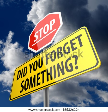 Did You Forget Something words on yellow Road Sign and Stop sign - stock photo