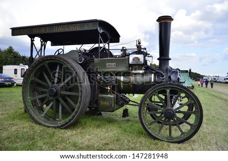 DIDCOT,OXFORDSHIRE, ENGLAND-JULY09-vint age steam traction engine with its owners on display in the show Woodcote Rally a country fair on July 09,2011 in Didcot England - stock photo