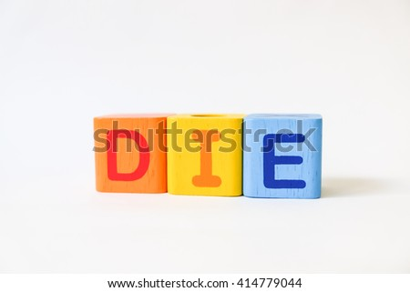 DIE word written on wood blocks, white background with copyspace - stock photo