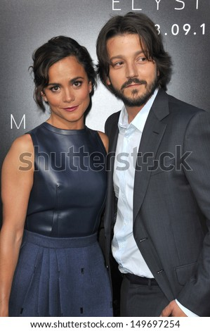 "Diego Luna & Alice Braga at the world premiere of their movie ""Elysium"" at the Regency Village Theatre, Westwood. August 7, 2013  Los Angeles, CA - stock photo"