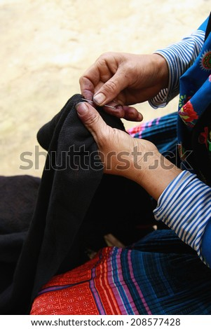 Dien Bien Phu, Dien Bien, Vietnam August 1, 2014: Drawing on dresses handmade in the suburbs of Hmong in Dien Bien Phu City, Dien Bien