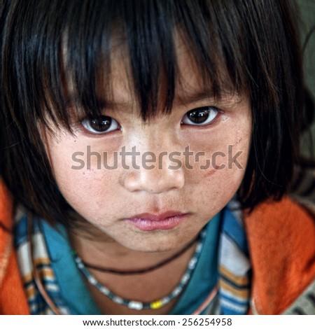 Dien Bien Phu - Vietnam, February 25, 2015: A Hmong unidentified ethnic minority children in Dien Bien Phu, Vietnam. - stock photo