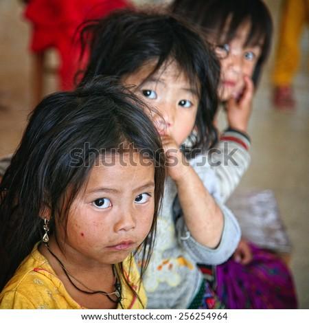 Dien Bien Phu - Vietnam, February 25, 2015: The Hmong unidentified ethnic minority children in Dien Bien Phu, Vietnam. - stock photo