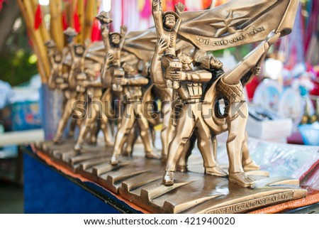 Dien Bien Vietnam May 12 2016 carved gold statue Vietnam military victory souvenirs on souvenir Shop in Dien Bien Phu,Vietnam