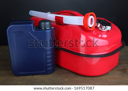 Diesel and oil canisters on grey background
