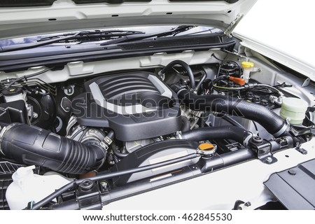 Diesel engine under the hood of a pickup truck.