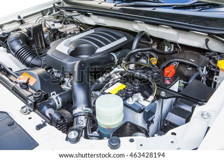Diesel engine under the hood of a pickup truck