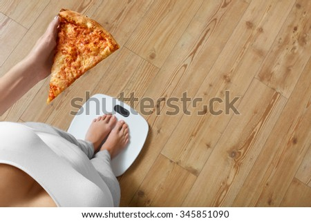Diet And Fast Food Concept. Overweight Woman Standing On Weighing Scale Holding Pizza. Unhealthy Junk Food. Dieting, Lifestyle. Weight Loss. Obesity. Top View - stock photo
