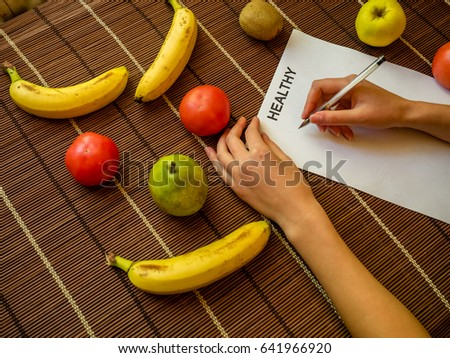 Diet and fitness - proper nutrition, healthy lifestyle, Measuring tape, bananas, apples, Bananas, apples pear