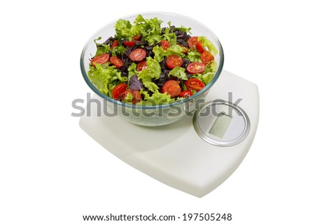Diet and healthy food. Vegetables salad in a bowl with weight scale, isolated on white background  - stock photo