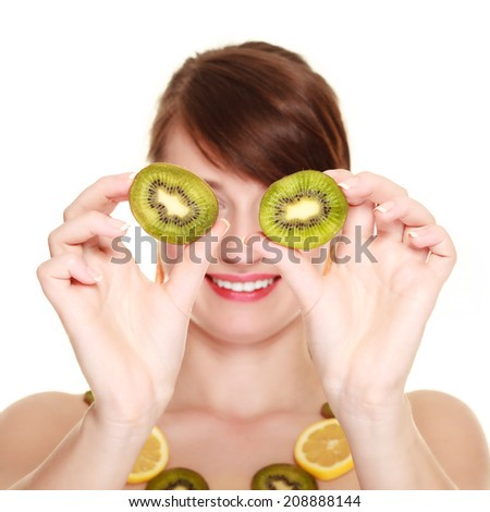 Diet and nutrition. Woman in necklace of citrus fruits covering eyes with slices of kiwi isolated on white. Girl doing fun. - stock photo
