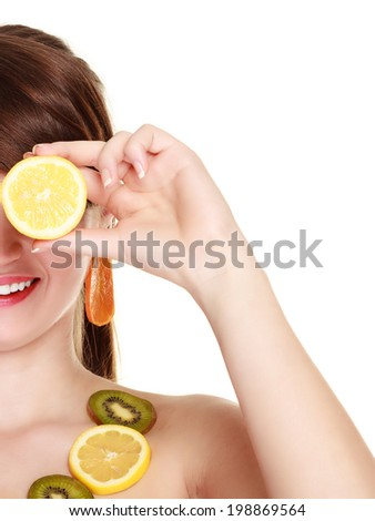Diet and nutrition. Woman in necklace of citrus fruits covering eyes with slices of lemon isolated on white. Girl doing fun. - stock photo