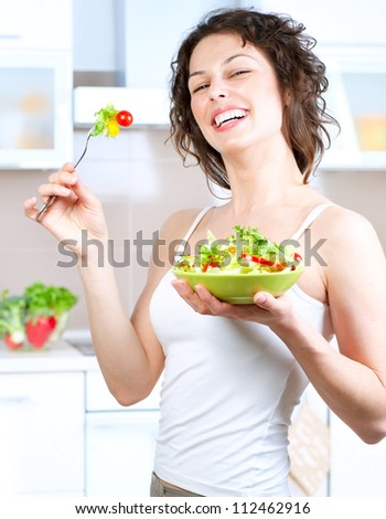 Diet.Beautiful Young Woman Eating Vegetable Salad .Dieting concept.Healthy Food