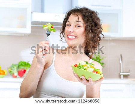 Diet.Beautiful Young Woman Eating Vegetable Salad .Dieting concept.Healthy Food - stock photo
