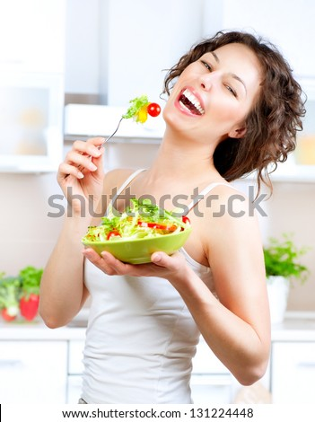 Diet. Beautiful Young Woman Eating Vegetable Salad. Dieting concept. Healthy Food