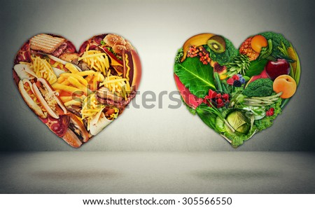 Diet choice dilemma and heart health concept. Two hearts one shaped of green vegetables fruit and alternative one made of  fatty junk high calorie food. Heart disease and food medical health care  - stock photo