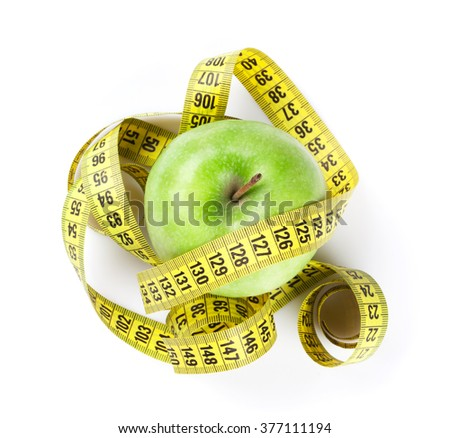 Diet concept. Apple and tape measure. Isolated on white background - stock photo