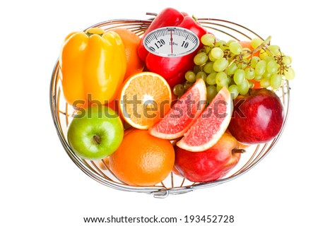 Diet concept. Colorful fruits in a basket isolated on white background - stock photo
