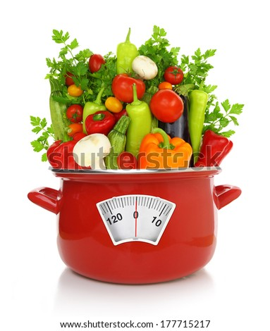 Diet concept. Colorful vegetables in a red cooking pot