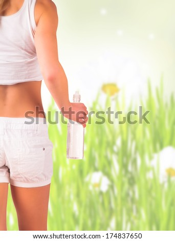Diet concept. Fit blond woman with natute background