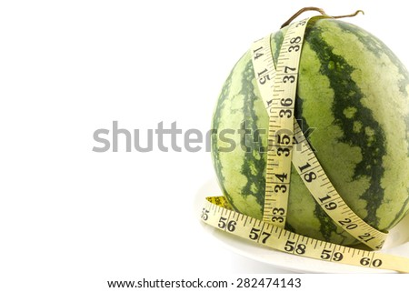 Diet concept Fresh green melon with measuring tape isolated on white background
