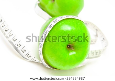 Diet concept . Healthy Living - nutrition and exercising, apple and measurement.