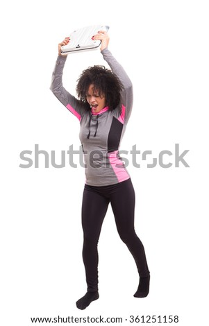 Diet concept - Mad woman destroying her scale - stock photo