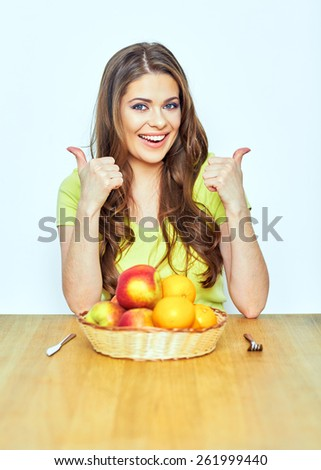 diet concept portrait of young woman showing thumbs . isolated  - stock photo