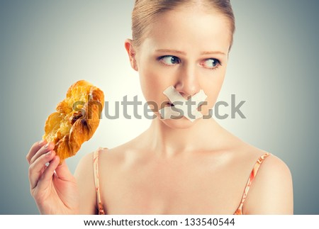 diet concept. woman mouth sealed with duct tape dreaming of biscuits and buns. - stock photo