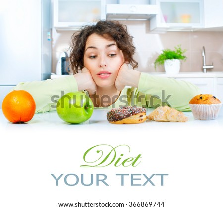 Diet. Dieting concept. Healthy Food. Beautiful Young thinking Woman choosing between Fruits and Sweets. Weight Loss  - stock photo