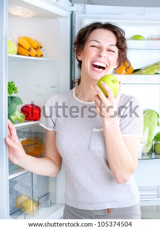 Diet.Dieting. Healthy Food concept, Beautiful Young Woman with Apple
