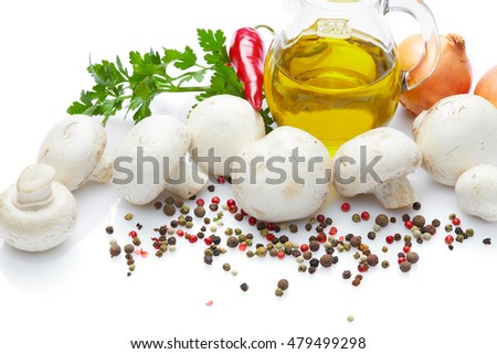 Diet food and drink and healthy lifestyle concept: Aromatic Fragrant fresh mushrooms with spices vegetables and herbs: Mushrooms with Olive Oil, onion,  pepper and parsley. Top view. Isolated on white