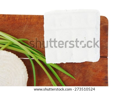diet food : greek feta white cheese served on small wooden plate isolated over white background - stock photo
