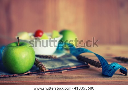 diet fruit apple centimeter wooden background - stock photo