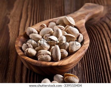 Diet healthcare concept. Roasted pistachio nuts seed with shell close up - stock photo