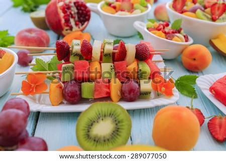 Diet, healthy fruit salad, fruit skewer - healthy breakfast, weight loss concept - stock photo