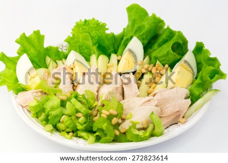 Diet lettuce egg boiled chicken pine nuts apple white background vitamins breakfast lunch dinner home cooking health organic eco low weight