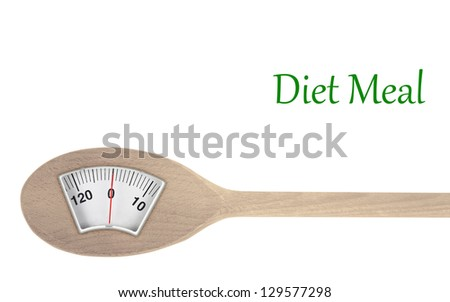 Diet meal. Wooden spoon with weight scale - stock photo