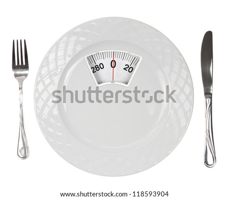 Diet menu. White plate with weight scale - stock photo