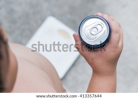 Diet. Obese fat boy holding soft drink can. - stock photo