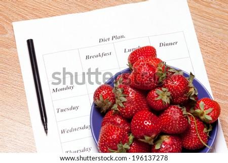 diet plan and fresh strawberries  - stock photo